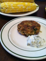 Frozen corn on the cob. It works. With salmon cakes and pantry pickle tartar sauce.